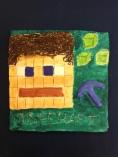 Tuomaksen reliefissä on Minecraft hahmo. Kuutioivaa tyyliä kuin kubismissa. :)